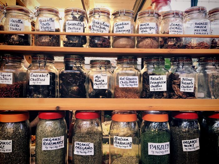 Various spices in jars for sale at store