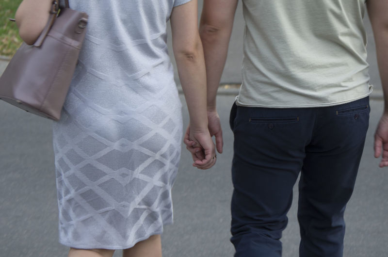 man and woman go holding hands Two Valentine's Day  Hands Husband Wife Couple Family Love Wife Lovers Army Copy Space Go Arm Handshaking Male Adult Close-up Hand Holding Holding Hands Lifestyles Love Men Outdoors Pair People Shake Hands Shaking Hands Women