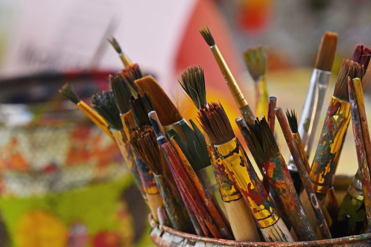 Clos-up of paintbrushes in container