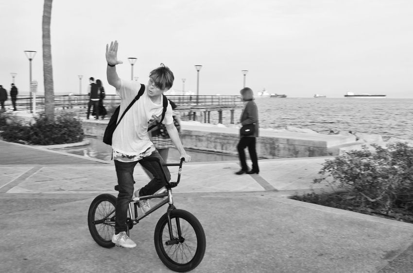 Hi Streetphoto Street Photography Street Photography Streetphoto_bw City Men Bicycle Riding Sea Sport Sky