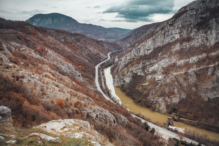 Beautiful picture of the canyon in Serbia, with river and the highway in the middle. Autumn colors Mountain Scenics - Nature Beauty In Nature Environment Mountain Range Non-urban Scene Tranquil Scene Nature Landscape Cloud - Sky Tranquility No People Rock Water Rock Formation Geology Outdoors Formation Power In Nature River Highway EyeEmNewHere Canyon Print My Best Photo
