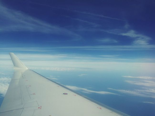 Horizon Over Water Window Seat Window Seat Airplane Wing Blue Skys No People Blue Outdoors Cloud - Sky Sky Transportation Sea Water Day Airplane Scenics Nature Beauty In Nature