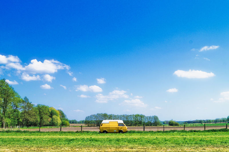 Backgrounds Background Copy Space Springtime Spring Sky Plant Field Land Tree Nature Mode Of Transportation Cloud - Sky Transportation Landscape Green Color Beauty In Nature Day Yellow Land Vehicle Grass No People Blue Sunlight Environment Outdoors It's About The Journey