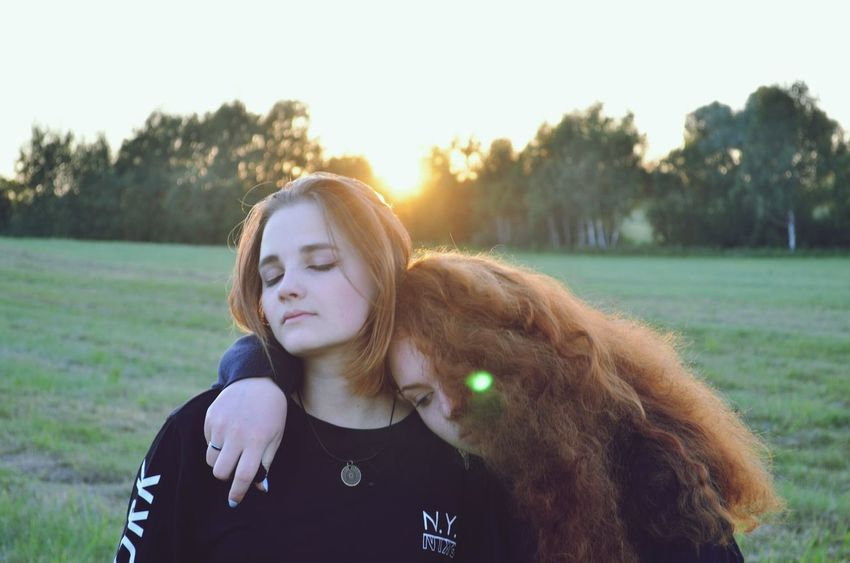 Front View Only Women Lens Flare Long Hair One Person Young Adult Adult People One Young Woman Only Sunlight Redhead Outdoors Adults Only Individuality One Woman Only Day Young Women Headshot Grass Rural Scene