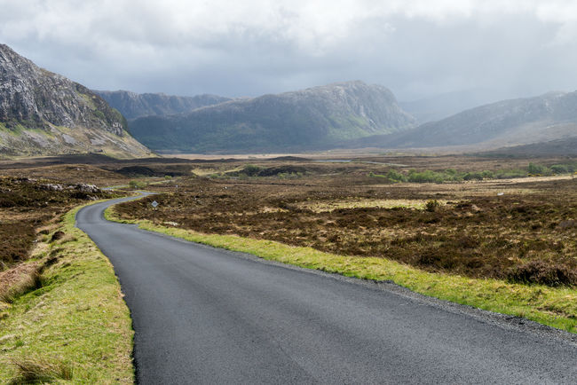 Scotland Asphalt Beauty In Nature Cloud - Sky Day Landscape Mountain Nature No People Outdoors Road Scenics Scottish Highlands Winding Road