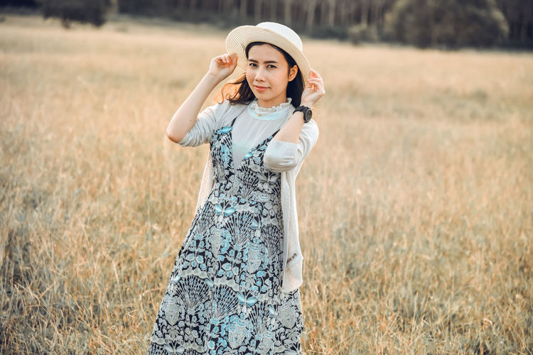 White women in the meadow Beautiful Woman Beauty Clothing Fashion Field Front View Land Leisure Activity Looking At Camera Nature One Person Outdoors Plant Portrait Real People Standing Three Quarter Length Women Young Adult Young Women
