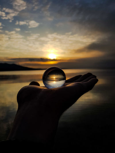 Feel the light... EyeEm Selects Lensball Hand Gramslayers Light Lights Nightphotography Night Lights EyeEmNewHere Sun Sunset Sunlight Sun Sunset Gold Colored Beach Nature Silhouette Sunlight Water Sea Outdoors Beauty In Nature No People Day Sky