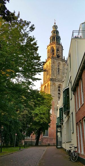 One autumn morning in Groningen, the Netherlands. Groningen Nederland The Netherlands Architecture Tower Towers Church Clock Tower City Travel Destinations Morning Light And Shadow Morning Light Historical Building Façade Heritage Building Historical Monuments