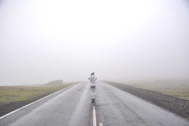 Adult Adults Only Adventure Cold Temperature Day Fog Full Length Human Body Part Landscape Nature One Man Only One Person Only Men Outdoors People Rear View Road Road Trip Sky Standing Straight The Way Forward Transportation Young Adult