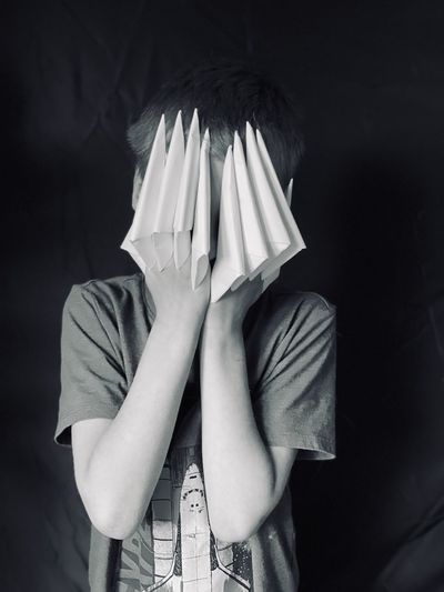 Midsection of a person hiding behind covering face