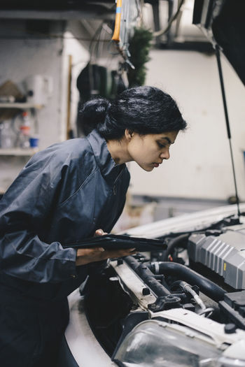 Side view of woman working
