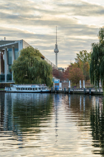 Morning walk in autumn in Berlin, Germany Architecture Built Structure Water Building Exterior Sky Cloud - Sky City Tower Travel Nautical Vessel Travel Destinations Waterfront Tall - High Nature Tree No People Reflection Transportation Spire  Outdoors Office Building Exterior Skyscraper Autumn Leaves Day Morning Sunrise