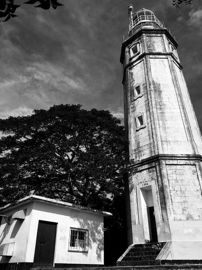 Tourism Iphoneonly IPhoneography IPhone Monochrome Black And White Blackandwhite Blackandwhite Lighthouse Light Architecture Building Exterior Built Structure Low Angle View Tree Sky Outdoors No People Day