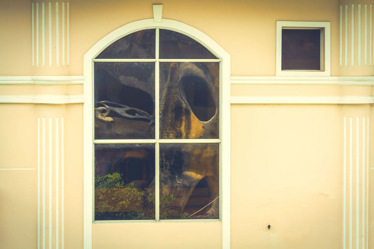 Windows Crazy Horse Vietnam Building Building Exterior Built Structure Close-up Closed Day Door Entrance Geometric Shape Glass Glass - Material House No People Outdoors Reflection Transparent Wall - Building Feature Window Window Frame Office Block Shutter Residential Structure Historic Exterior