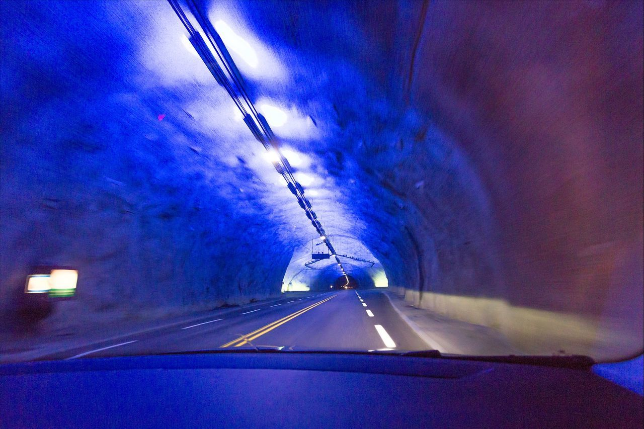 View of tunnel seen from windshield of car