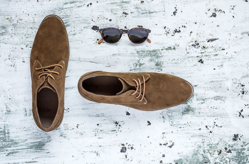 High angle view of sunglasses and shoes on table