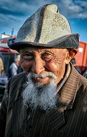 Beard Facial Hair Males  Senior Adult One Person Portrait Men Senior Men Adult Real People Clothing Lifestyles Hat Headshot Wrinkled Front View Close-up Looking At Camera Mustache Outdoors Contemplation Human Face