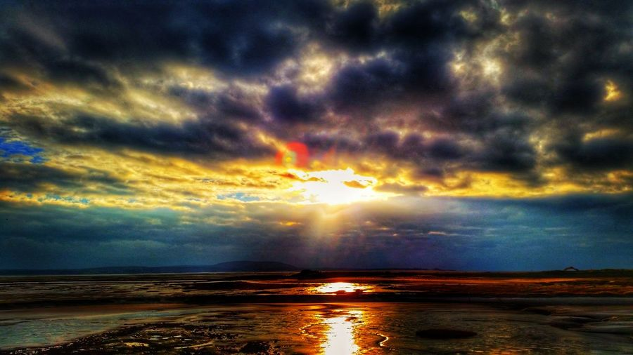 Water Sunset Scenics Sea Tranquil Scene Beauty In Nature Horizon Over Water Tranquility Beach Idyllic Sunbeam Sun Majestic Reflection Nature Cloud - Sky Dramatic Sky Sky Cloudscape Cloud Dramatic Sky Moody Sky