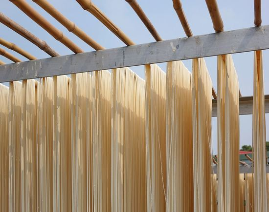 Traditionally manufactured noodles are hug up to dry Chinese Food Drying In The Sun Drying Rack Food Industry Hand-made Handmade Handmade Noodles Noodles Pasta Taiwan Traditional Food