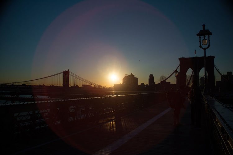 Brooklyn Bridge Sky Connection Architecture Bridge Built Structure Bridge - Man Made Structure Transportation Nature City Travel Destinations Sun Engineering Building Exterior Sunlight Suspension Bridge Travel Railing Tourism Sunset Illuminated Lens Flare Outdoors