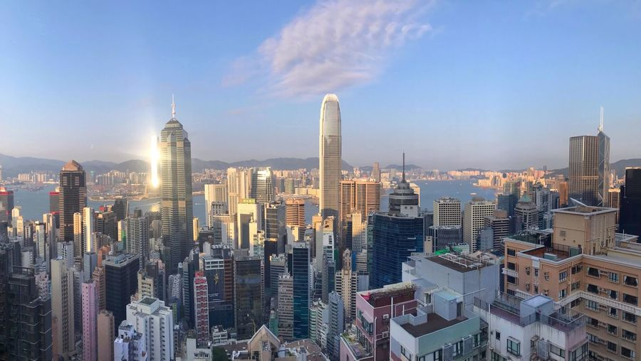 Hong Kong panorama Panorama Evening Sunlight Hong Kong Architecture Building Exterior Office Building Exterior Built Structure Building Skyscraper City Modern Sky Cityscape Tall - High Crowded Urban Skyline Travel Destinations Residential District My Best Photo The Mobile Photographer - 2019 EyeEm Awards The Traveler - 2019 EyeEm Awards