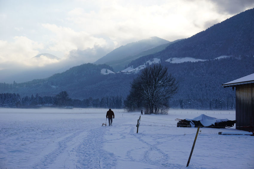 Way home Beauty In Nature Cloud - Sky Cold Temperature Day Landscape Mountain Mountain Range Nature One Person Outdoors People Schlitten Sky Sleigh Snow Snow ❄ Winter Winter Winterwalk