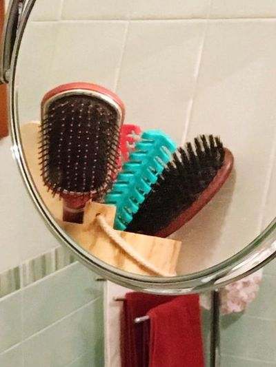 Hairbrushes at the mirro Mirror Indoors  Hygiene Close-up Container Still Life No People Domestic Bathroom Bathroom Hairbrush Body Care Domestic Room Home Mirror