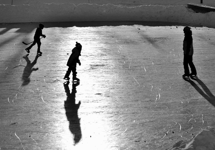 Blackandwhite Bnw Cold Family Hockey Ice Rink Iceskating Leisure Activity Lifestyles Monochrome Outdoors People Playing Pondskating Real People Shadow Skate Skating Skill  Sport Sunlight Winter Winter Sport Wintertime
