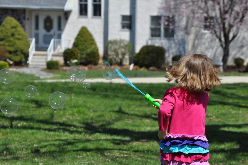 Young Girl Playing with Bubbles Bubble Bubble Wand Childhood Elementary Age Fun Girl Leisure Activity Motion One Person Outdoors Playing Real People Spring Summer Young Girl
