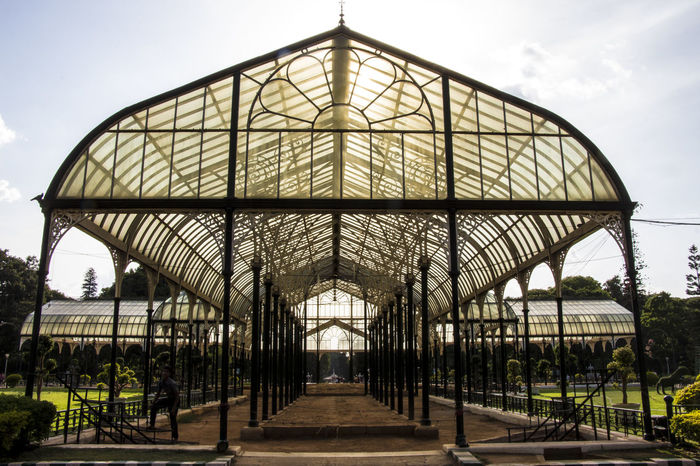 The Glass House - Lalbagh Botanical Garden Of the many artistic structures in Lalbagh, the Glass House is the most famous. In the necklace of Bangalore's gardens, Lalbagh is a pendant and in the centre of this pendant is the glass house in the form of a diamond. It was built in 1889 during the administration of Sri John Cameron to commemorate the visit of Prince of Wales. Designed on the lines of the Crystal Palace of England, it was intended for acclimatizing the exotic plant specimens. Today, as the jewel of Lalbagh, it is the centre stage for holding the famous biannual flower shows. Architectural Feature Architecture Built Structure EyeEm EyeEm Best Shots EyeEm Best Shots - Nature EyeEm Gallery EyeEm Nature Lover EyeEmBestPics F/∞ Façade Outdoors Sky Sohillaad SohilLaadPhotography