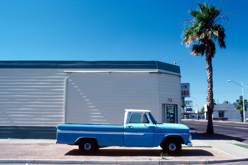Architecture Blue Building Exterior Built Structure Car City Clear Sky Day Land Vehicle Mode Of Transportation Motor Vehicle Nature No People Outdoors Palm Tree Pick Up Plant Sky Street Transportation Tree Tropical Climate