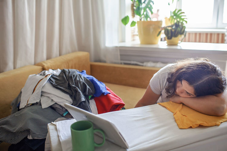 High angle view of woman sleeping on bed at home