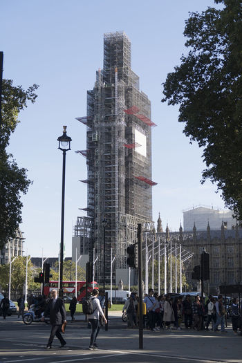 London, United Kingdom - October 11, 2018; Famous landmark Big Ben in London under scaffolding for repair work during a six year renovation seen from the side of the houses of parliament Renovation Big Ben Big Ben, London Houses Of Parliament - London London United Kingdom Building Exterior Architecture Landmark Scaffolding Street Photography Street Life