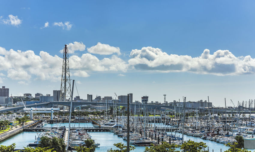 Leisure boats lined in the ginowan harbor marina seen from okinawa conversion center
