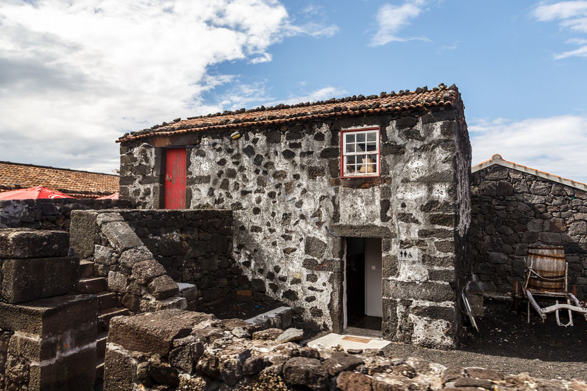 Azores Pico Island Traditional House Architecture Basaltic Rock Building Building Exterior Built Structure Cloud - Sky Day History House Nature No People Old Outdoors Residential District Ruined Sky Stone Wall Sunlight The Past Wall Weathered Window