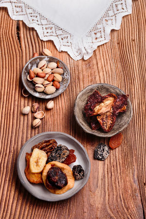 Dried fruits and nuts in handmade pottery bowls on old wooden table from above Freshness Rustic Snack Above Ceramic Delicious Directly Above Dried Dried Fruit Food Fresh Healthy Healthy Eating No People Overhead View Pottery Still Life Table Tasty Wooden