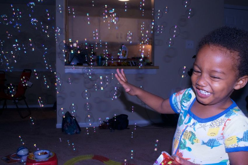 Zaheer playing with bubbles in North Carolina. 2017 ArtWork Baby Bubbles Fun New Nikon Bubble Wand Child Childhood Flash Indoors  One Person People Photography Real People Toddler  Vacation EyeEm Ready   The Still Life Photographer - 2018 EyeEm Awards