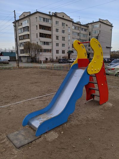 View of playground against buildings