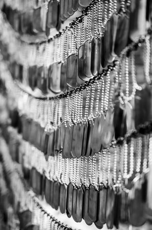 A small portion of a wall of dog tags to create this nice black and white pattern. Airforce Army Blackandwhite Culture Detail Doglegs Dogtags Forces Identification Metal Military Repetition Still Life USA