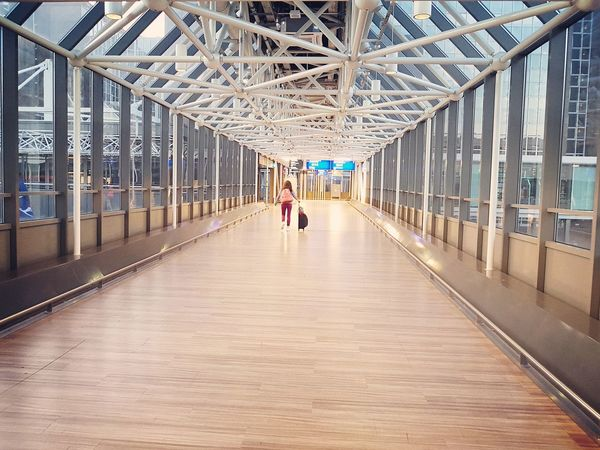 Airport Airportphotography Airport Frankfurt Traveler From Behind Lines And Patterns Full Length Bridge - Man Made Structure Walking Architecture Built Structure