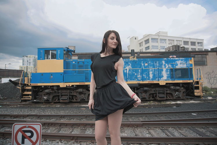 NYC Urban City Industry Industrial Day Clouds Outdoor Sexygirl Legs Bad Weather Model Young Women Portrait City Beauty Railroad Track Looking At Camera Fashion Train - Vehicle Beautiful Woman Beautiful People Locomotive Train Rail Transportation Railroad Station Platform Freight Train Mini Skirt Sundress Train Track The Portraitist - 2018 EyeEm Awards Urban Fashion Jungle