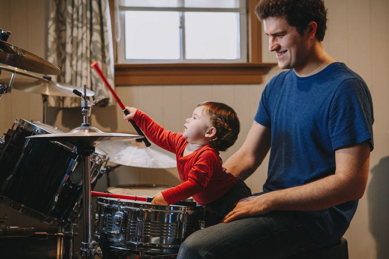 Father and son playing in store