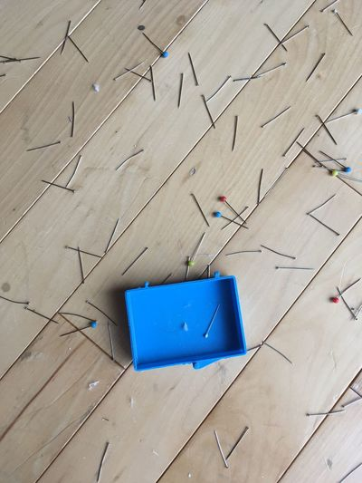 Box Chaos Perspective Pins Sewing Sewing Stuff Blue Blue Box Close-up Dropped Empty Empty Box High Angle View Push Pins Sewing Accessories Sewing Item Sewing Needle Single Spilled Wood - Material