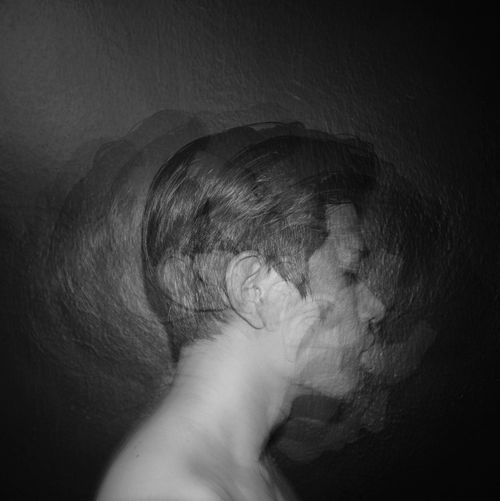 Close-up of woman sleeping in darkroom