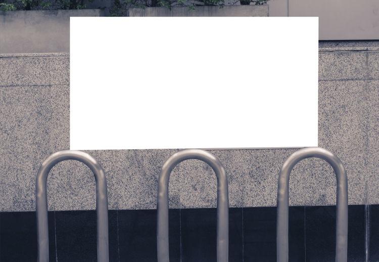 Metal railing against wall