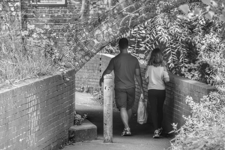 Two People Togetherness Adults Only Adult People Growth Full Length Outdoors Friendship Real People Bonding Monochrome Black And White People Watching Walking Bridge Tunnel Under Bushes Standing Day Nature Ashford Kent Walking Away Walks The Week On EyeEm