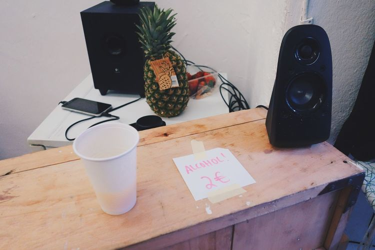 music, pineapple & alkohol Indoors  Speaker Music Plastic Cup Sign Table No People Drink Pineapple Fruit