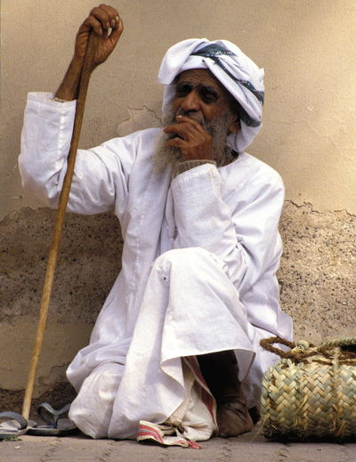 Aged Back Against The Wall Dishdasha Loneliness Man Massar Old Man One Man Only Pondering Pondering Man Pondering Old Man Sitting Sitting And Waiting Stick Waiting Waiting Sitting Walking Stick White Dishdasha White Massar