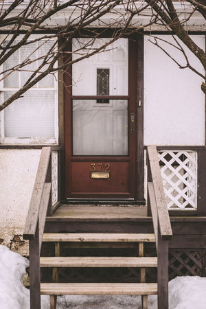 Building Exterior Built Structure Day Door Entrance Framed Front Porch Old House Residential Building Residential Structure Trees Window Winter