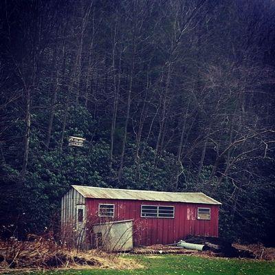 Red tin shack Ruraldecay Backroads Poconos Lehigh mountain stream tires landscape deepwoods rust vignette